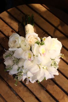The ultimate Spring wedding bouquet.  Cymbidium orchids, roses, ranunculus and wax flower bouquet.  All these flowers are in bloom in Spring!