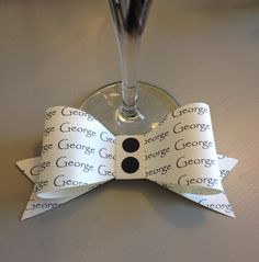 Handmade and personalised paper 'dickie' bow place marker/favour. Suitable for weddings, dinner parties and special occasions. by PaperClass on Etsy