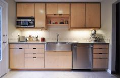 Donna's kitchen by Kerf Design. Kerf Design is a custom cabinet shop located in Seattle, WA that ships nationwide. They specialize in exposed edge europly (aka appleply) plywood and italian laminate in bright modern colors. kerfdesign.com