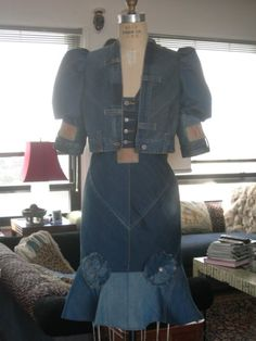 denim upcycle. i like everything but the little rosettes on the skirt seam.