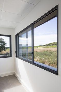Fen tre xxl mur de verre baie vitr e conseils d for Fenetre coulissante rectangulaire