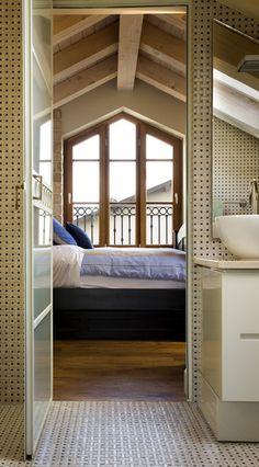 Custom-shaped window in wood for a modern bedroom