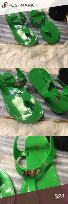 Michael Kors Glossy Rubber Sandals Like new Michael Kors sandal with gold plate in the front. Item has been gently used but does not have any major flaws. On one sandal however there is some darkening as shown in the picture. KORS Michael Kors Shoes Sandals