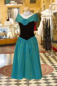 Cabaret Vintage - Vintage 1960s Emerald and Black Gown, $195.00 (http://www.cabaretvintage.com/dresses/vintage-1960s-emerald-and-black-gown/)