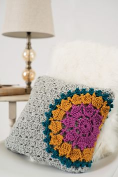 This corner-to-corner crochet project features a mandala that seems to burst from its side of the pillow cover. With its added border and sweet handmade touch, this gift will make mom will think of you every time she relaxes on the couch.