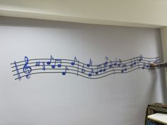 Magnetic music creation for wall decor. The black lines are made of magnetic material which one can obtain from a shop with aluminum construction or a manufacturer. 😉The notes are wooden and on the back of it, So the notes can be easily moved to create new melodies. 😍😍The building is suitable for music learning rooms, classrooms, as well as student bedrooms that like music. 🎶🎵Still the notes can be replaced with some other design scheme (such as stars, car, etc.) Good create on.☺️☺️
