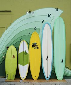 Fresh resin tints and a freshly painted wall at Harbour Surfboards