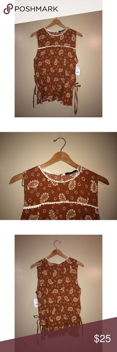 Zara Sleeveless Paisley Blouse BRAND NEW WITH TAGS! Zara paisley printed, sleeveless top. Adjustable strings on sides, keyhole button back. Size LARGE. Zara Tops Blouses