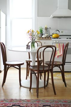Vintage and modern paired nicely- Editor Kaczmarski's Home Tour // kitchen // tulip table and bentwood chairs // yellow and gray Dining Nook, Saarinen Tulip Table, Dining Room Design, Home Decor, House Interior, Home Deco, Dining Room Decor, Interior Design, Tulip Dining Table