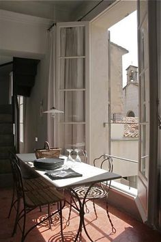 charming apartment with balcony and french doors, European, breakfast table