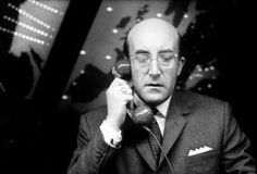 Peter Sellers played three roles in Stanley Kubrick's Dr. Strangelove – British officer Lionel Mandrake, U. President Merkin Muffley, and ex-Nazi nuke expert Dr. Best Director, Film Director, Ill Communication, Slim Pickens, Dr Strangelove, Jean Luc Godard, Famous Movies, Political Satire, Stanley Kubrick