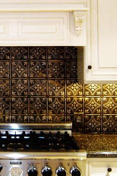 Bronze backsplash, white cabinets, rubbed bronze hardware, stainless appliances, darker granite...yesss this is exactly what I'm going for