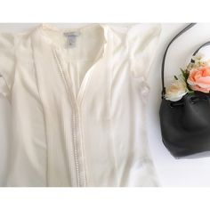 Host Pick  H&M blouse Cream colored with short flowy sleeves. Has cute detailing in front. H&M Tops Blouses
