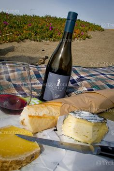 Beach picnic with red wine, bread and cheese