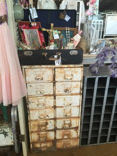 An old suitcase is an awesome way to display vintage religious items