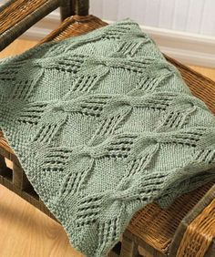 Cable Knit Throw. Knit with interesting cable pattern. Beautiful. In white or off-white, it would look vintage. In a charcoal or taupe, it would look modern.