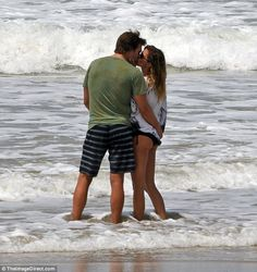 Sealed with a kiss: Gisele and Tom Brady wrapped up their Costa Rica family vacation over the weekend with an affectionate display on the beach