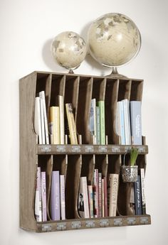 Old mail sorter used for home organization.