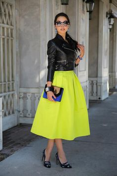 Love the idea of neon fancy full skirt + black moto jacket with ladylike heels and clutch.