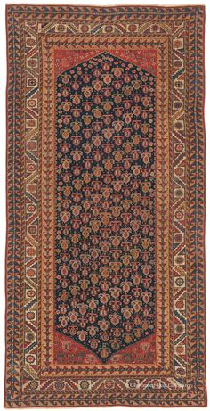 QASHQAI, Southwest Persian, 3ft 10in x 7ft 4in, Circa 1850. This striking tribal rug is a quite rare over 150-year-old example of the extremely refined weaving and sumptuous dyeing of the most dexterous Qashqai tribal weavers. A desert people who were forever grateful for miracle of life, they often populated their carpets with boteh, or sprouting seed motifs, as in this astonishing antique rug. The field and borders of this tribal rug comprise a tour de force of splendiferous detail.