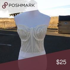 Women's corset Women's cream colored corset with removable straps. Corset has 7 closures in back. Goddess Intimates & Sleepwear Bras