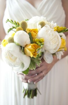 bouquet of yellow roses, white peonies and yellow freesia