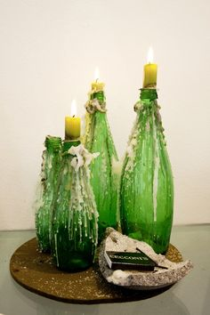 old bottles as candle holders. can be used after dripped wax has dried as mismatched vases for home