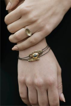 The Saturn Ring and Coral Slice,  Roma, and Ponte Bangles. Click through to see more pieces from the Gold Collection. Modeled by Sarah Hiromi and photographed by Shayna Fontana.