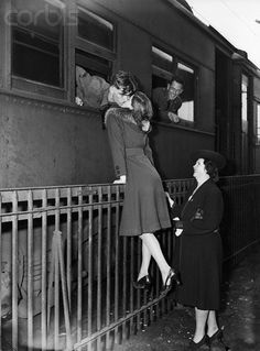 Goodbye kiss at train station