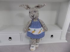 Pdf knitting pattern for a lovey little baby bunny toy dressed up in her gorgeous blue dress with a repeat carrot motif design.  Pattern