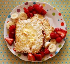 coconut crusted french toast with bananas and berries