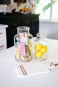 glass jars with vintage fish tins and lemons. / sfgirlbybay