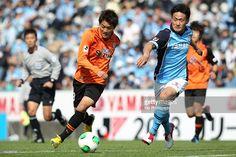 Toshiyuki TAKAGI of Shimizu S-Pulse dribbles the ball under the pressure from Shunya SUGANUMA of Jubilo Iwata during the J.League Yamazaki Nabisco Cup match between Jubilo Iwata and Shimizu S-Pulse at Yamaha Stadium on March 23, 2013 in Iwata, Shizuoka, Japan.
