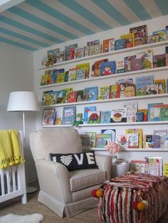 An entire wall of books. Fun way to display books for kids to see, and probably easier for them to put away also.