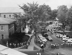 U.S. Marshals form a line around the Administration building at the University of Mississippi at Oxford, Miss., Sept. 30, 1962. The Marshals moved onto the campus to force enrollment of James Meredith, the first black student enrolled at the university. (AP)