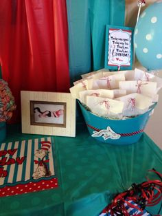 """Dr. Seuss Birthday Party Favor Table  """"1 Fish 2 Fish, Put These in Your Soap Dish"""" Favor Bags: Credit to Prissy Party Printables  https://www.etsy.com/shop/PrissyParty?ref=s2-header-shopname  Cat in the Hat Portrait: Credit to Dina Marie Photography"""