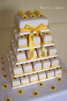 Sunflower miniature wedding cake tower. Indian Weddings Inspirations. Yellow Wedding Cake. Repinned by #indianweddingsmag indianweddingsmag.com #weddingcake