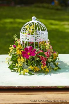 Wedding style inspiration: learn how to create this beautiful floral birdcage centerpiece for your garden party wedding - and find more ideas and tips - in Style Your Perfect Wedding