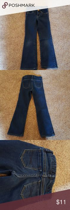 Size 5 slim Gap kids bootcut dark wash jeans These are a five slim that I purchased for my daughter. Unfortunately she wore them one or two times only before growing out of them. They are in excellent used condition. Gap Bottoms Jeans