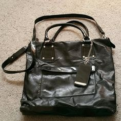 Pocket book Black hand bag with detachable strap..good condition..ink pen marks on inside..small tear on back towards bottom Liz Claiborne Bags