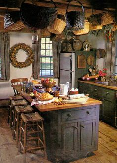 Prim Kitchen...hanging baskets & old crocks on the fridge.--refrig looks neat how is utilized with wood for primitive look and use