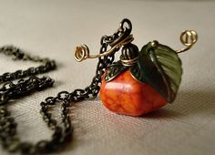 Hey, I found this really awesome Etsy listing at http://www.etsy.com/listing/112007191/pumpkin-necklace-genuine-howlite-and