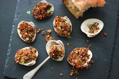 These bacony, buttery and briny stuffed clams—called almejas in Spain—are Andrew Zimmern's preferred version of clams casino. Plus: Andrew Zimmern's Kitchen Adventures Video: How to Shuck a Clam or Oyster Clam Recipes, Best Seafood Recipes, Wine Recipes, Cooking Recipes, Easy Recipes, Tapas, Clams Casino, Spanish Dishes, Spanish Recipes