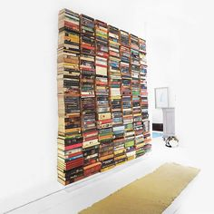 Creative Ronja Lotte created an attractive Floating Book Wall made out of upcycling hardcover books, turning them into floating/hidden bookshelves