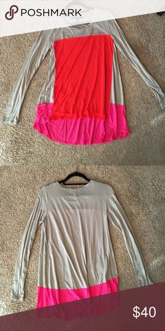 BCBGmaxazria color block long sleeve tee This BCBG color block long sleeve tee is in great condition. Only worn once. Super flattering when one. Size S BCBGMaxAzria Tops Tees - Long Sleeve