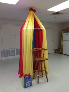 Circus Party... I love this circus tent out of plastic table cloths & a hula hoop. Great for the star as they show it, or over the food & activities.
