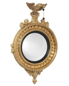 Wood and composition round girandole convex mirror with eagle with two black balls, bottom with pineapple finial and additional applied decoration. Shown with b