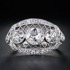 Edwardian Three-Stone Diamond Ring, circa 1900. Love the openwork under the gallery.