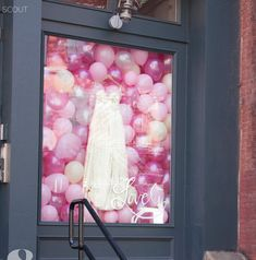 pink balloon storefront window display
