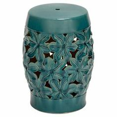 """Indoor/outdoor ceramic garden stool with an openwork floral design. Product: Garden stool     Construction Material: Ceramic  Color: Blue-green  Features: Suitable for indoor and outdoor useOpenwork floral design    Dimensions: 18"""" H x 13"""" Diameter"""